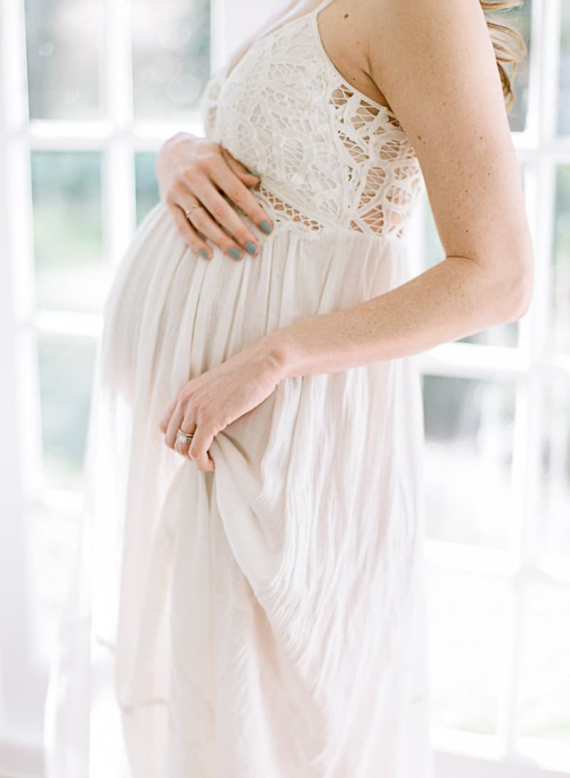 Portrait of baby bump in white lace dress in Savannah Photography Studio