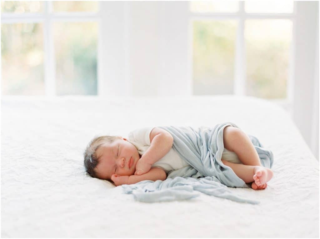 newborn baby boy portrait on white backdrop