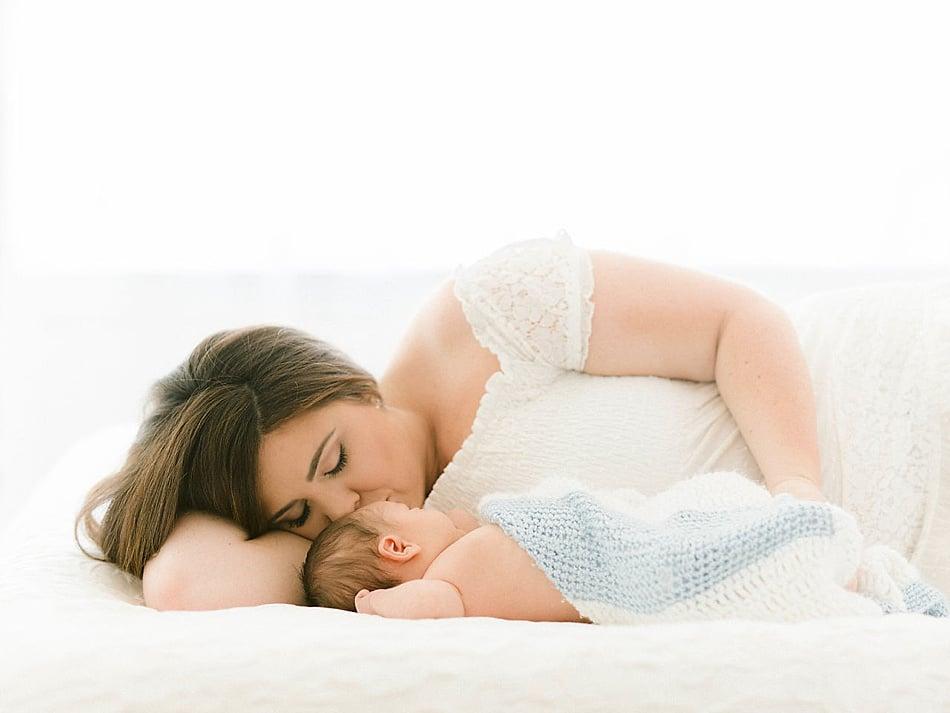 Portrait of mom snuggling baby boy